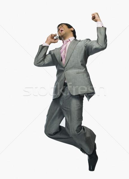 Empresário falante telefone móvel sorrir homem feliz Foto stock © imagedb