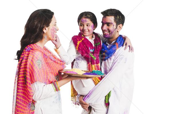 Family celebrating Holi festival Stock photo © imagedb
