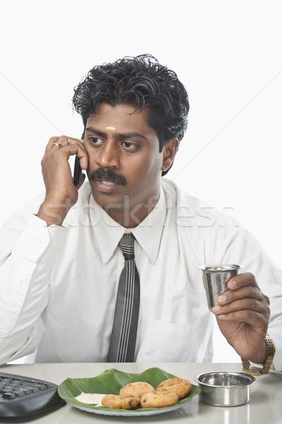 Sul indiano empresário falante telefone móvel comida Foto stock © imagedb