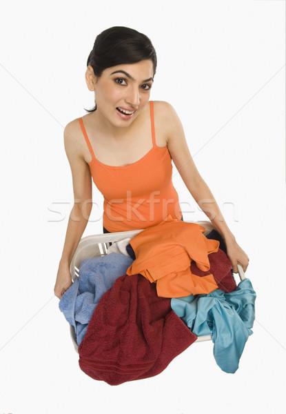 женщину корзина для белья чистой улыбаясь счастье Сток-фото © imagedb