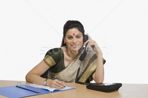 Stok fotoğraf: Işkadını · konuşma · telefon · ofis · kadın · kalem