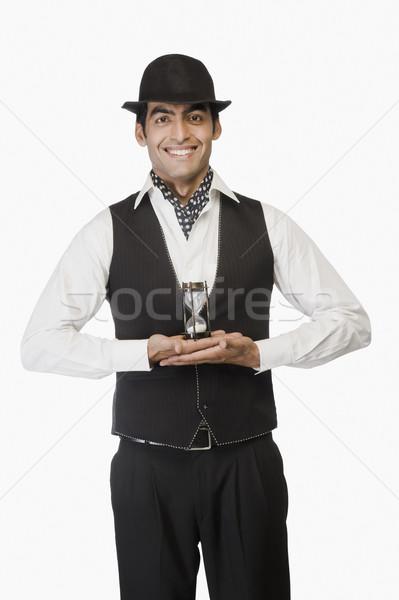 Portré üzletember tart homokóra üzlet idő Stock fotó © imagedb