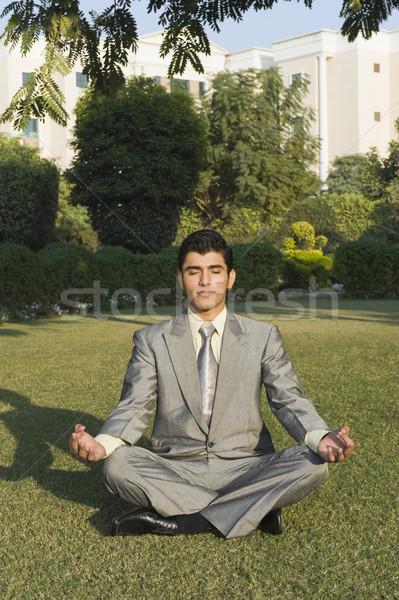 бизнесмен йога парка бизнеса человека Сток-фото © imagedb