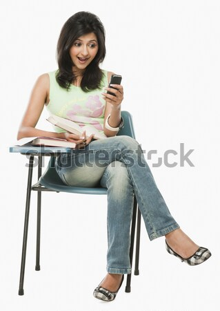 глядя мобильного телефона удивление женщину книга Сток-фото © imagedb