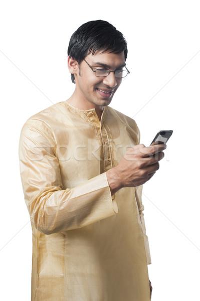 Man mobiele telefoon glimlachend geluk verbinding Stockfoto © imagedb