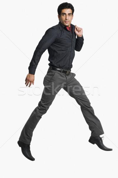 Сток-фото: портрет · человека · прыжки · белый · обуви · фотографии