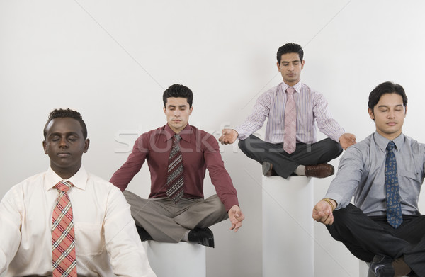 Quatre affaires yoga affaires exercice Photo stock © imagedb