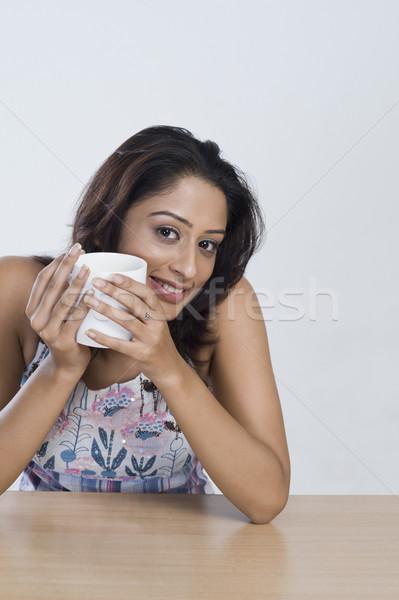 Kadın içme kahve genç gülen mutluluk Stok fotoğraf © imagedb