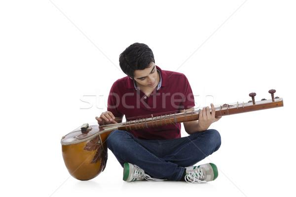 человека сидят полу играет джинсов молодые Сток-фото © imagedb