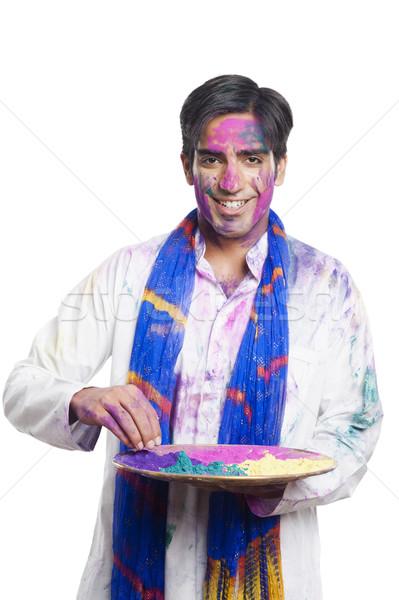 Man holding a plate of powder paint on Holi Stock photo © imagedb