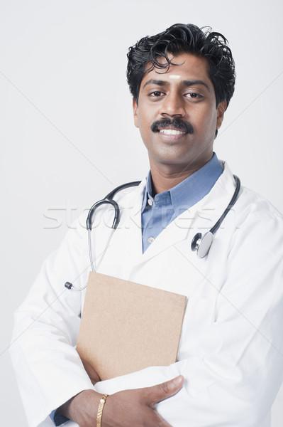 Güney Hint doktor gülen stetoskop 20s Stok fotoğraf © imagedb
