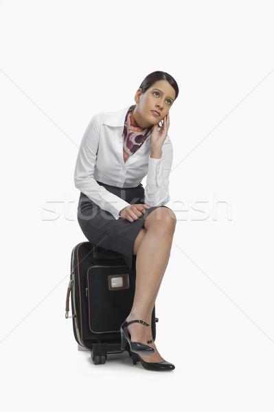 Hava hostes oturma bagaj düşünme bacaklar Stok fotoğraf © imagedb