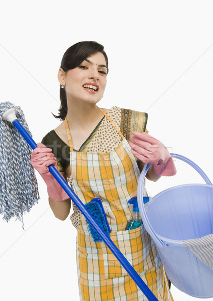 Nő tart ház dolgozik tiszta mosolyog Stock fotó © imagedb