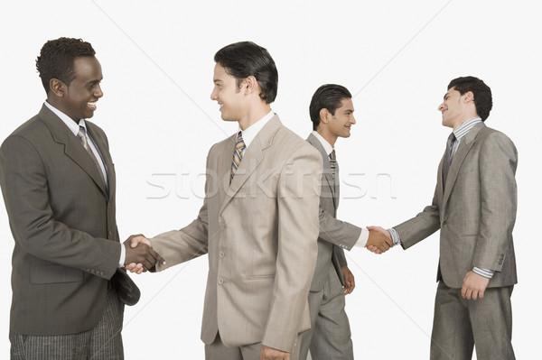 4 ビジネスマン 握手 ビジネス ビジネスマン ハンドシェーク ストックフォト © imagedb
