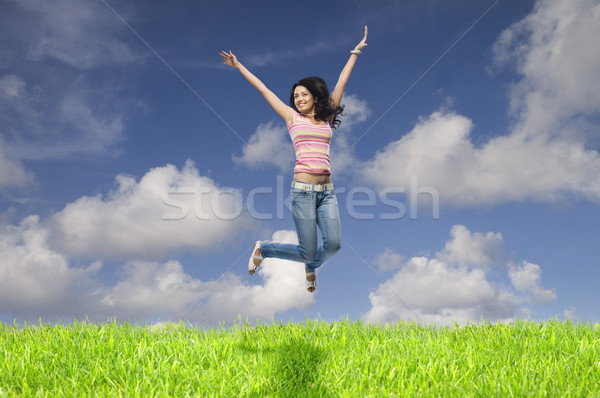 прыжки области женщину небе красоту Сток-фото © imagedb