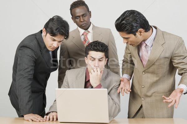 Négy üzletemberek dolgozik laptop üzlet üzletember Stock fotó © imagedb