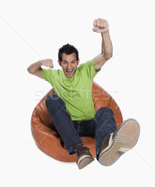 Retrato homem saco de feijão verde jeans Foto stock © imagedb