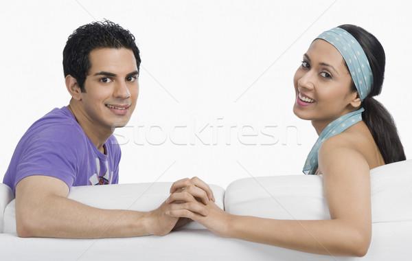 Portret para uśmiechnięty sofa posiedzenia fotografii Zdjęcia stock © imagedb