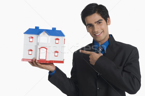 Makelaar wijzend model home business man Stockfoto © imagedb