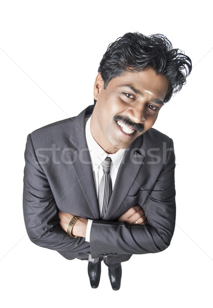 South Indian businessman standing with his arms crossed Stock photo © imagedb