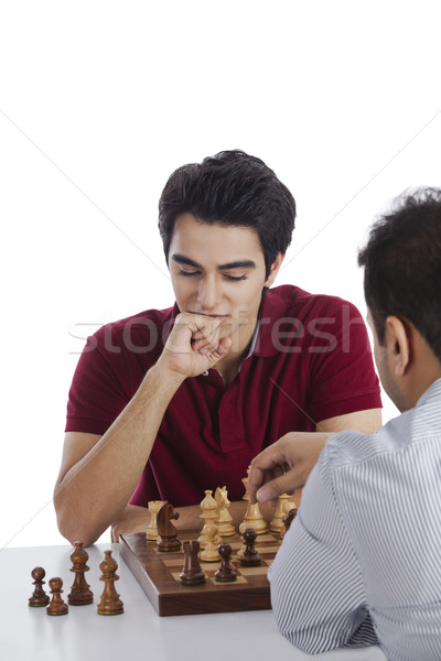 Két férfi játszik sakk asztal férfiak boldogság Stock fotó © imagedb