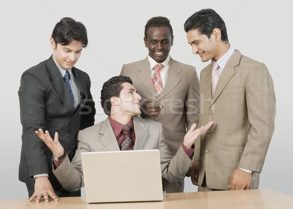 Négy üzletemberek laptop üzlet technológia üzletember Stock fotó © imagedb