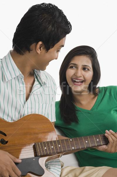 Сток-фото: человека · играет · гитаре · женщину · музыку