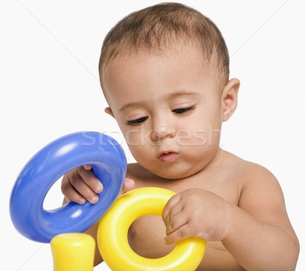 Bebek erkek oynama oyuncaklar halka sevimli Stok fotoğraf © imagedb