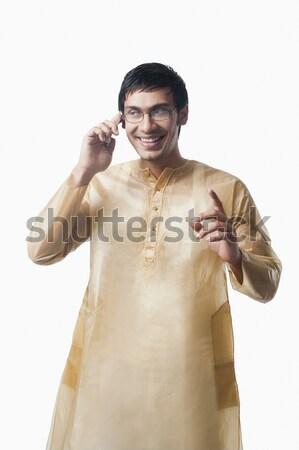 Bengali man talking on a mobile phone Stock photo © imagedb