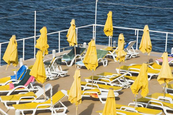 Fedélzet székek tengerpart esernyők turistaövezet Málta Stock fotó © imagedb