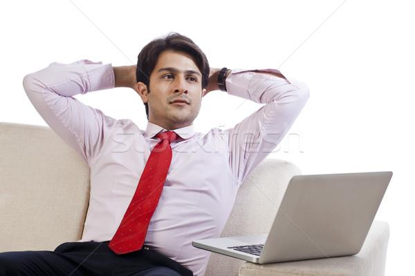 Işadamı oturma kanepe bakıyor düşünme dizüstü bilgisayar Stok fotoğraf © imagedb