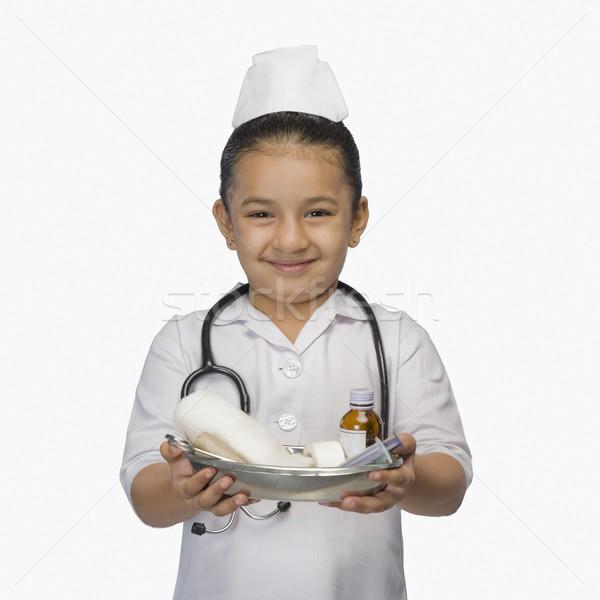 Kız hemşire tepsi çocuk tıp Stok fotoğraf © imagedb