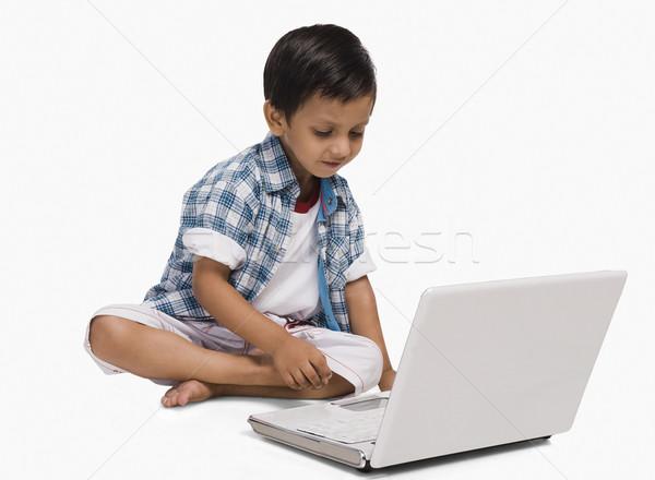 Boy using a laptop Stock photo © imagedb
