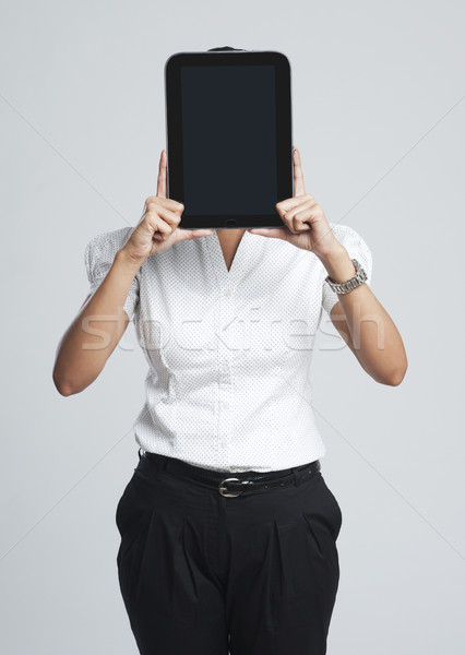 Businesswoman showing a digital tablet Stock photo © imagedb
