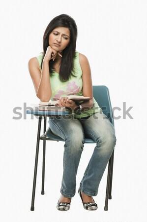 Woman using a laptop Stock photo © imagedb