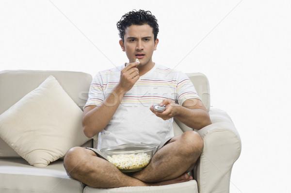 Hombre mirando sorprendido sofá elección Foto stock © imagedb