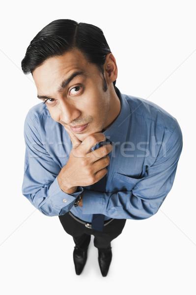 Bengali businessman thinking Stock photo © imagedb