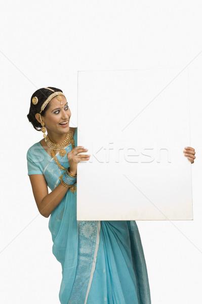 женщину плакат улыбаясь молодые белый Сток-фото © imagedb