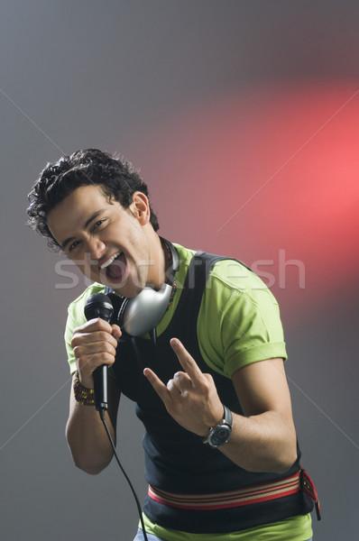 Adam şarkı söyleme mutluluk eğlence renkli görüntü zevk Stok fotoğraf © imagedb