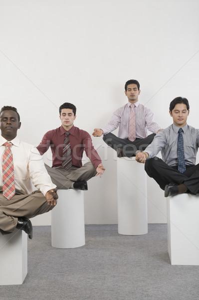 Négy üzletemberek gyakorol jóga üzlet testmozgás Stock fotó © imagedb