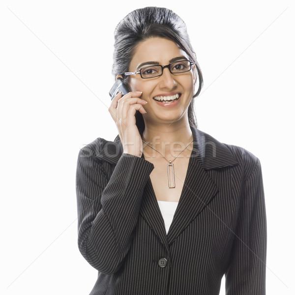 портрет деловая женщина телефон улыбаясь мужчины 20-х годов Сток-фото © imagedb