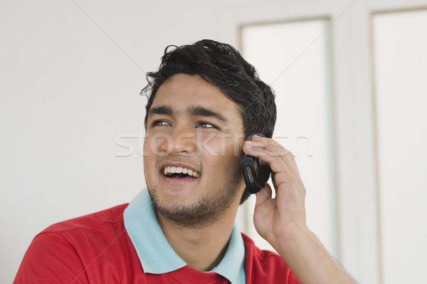 человека говорить мобильного телефона улыбаясь связи Сток-фото © imagedb