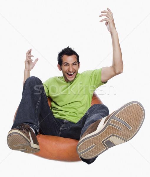 Homem saco de feijão jeans camisetas sorridente Foto stock © imagedb