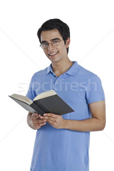 Portré férfi olvas könyv mosolyog oktatás Stock fotó © imagedb