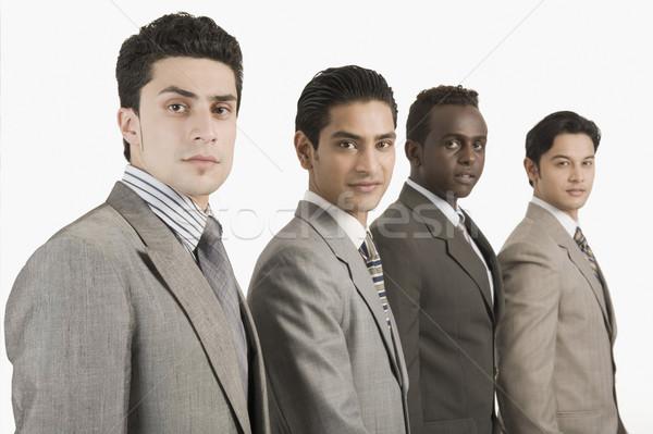Portré négy üzletemberek áll együtt üzlet Stock fotó © imagedb