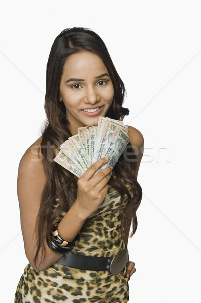 Kadın para notlar gülen finanse Stok fotoğraf © imagedb
