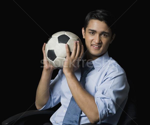Empresario balón de fútbol hombre sonriendo sesión Foto stock © imagedb