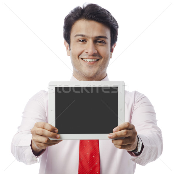 Portrait of a businessman showing a digital tablet Stock photo © imagedb