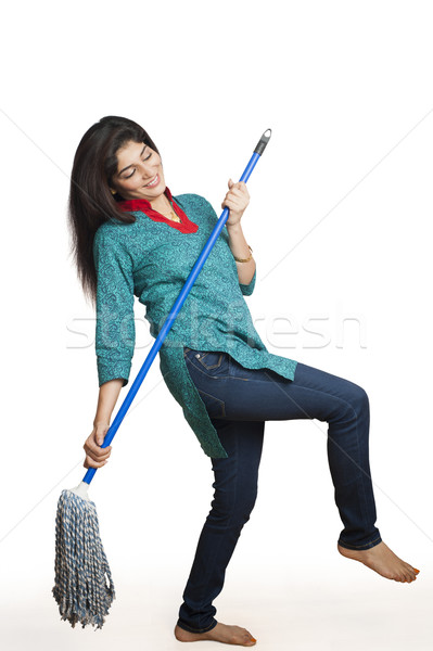 Woman cleaning floor with a mop Stock photo © imagedb