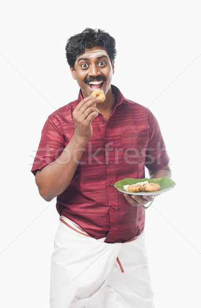 South Indian man having vada Stock photo © imagedb